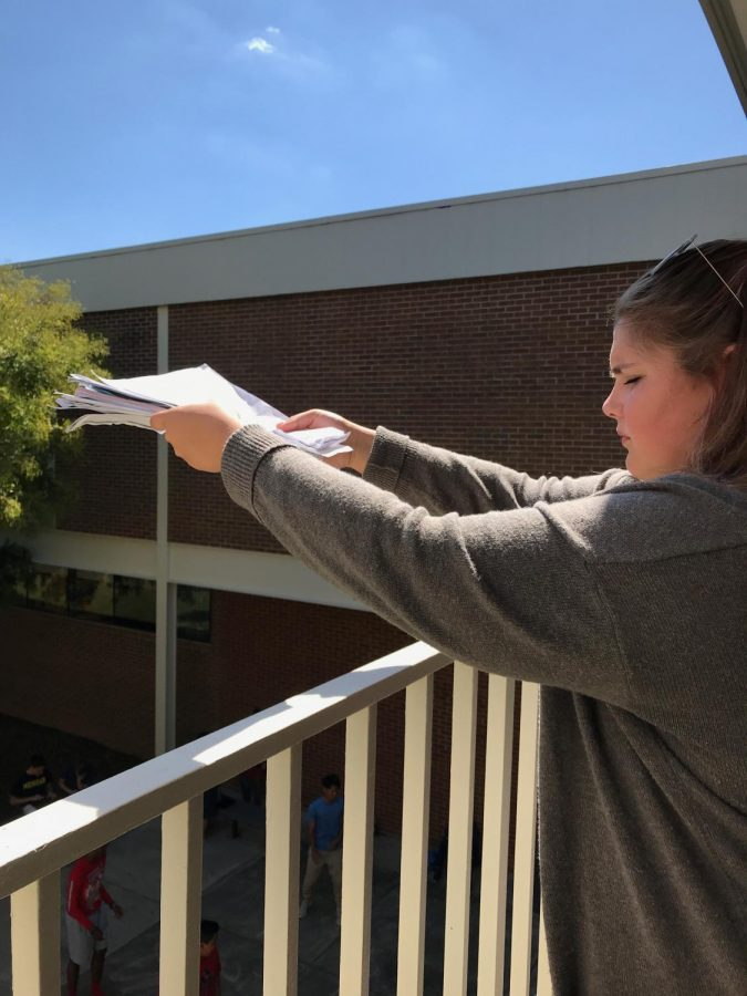 Gabby+Safley+%2812%29+prepares+to+throw+a+stack+of+cornell+notes+off+the+balcony.