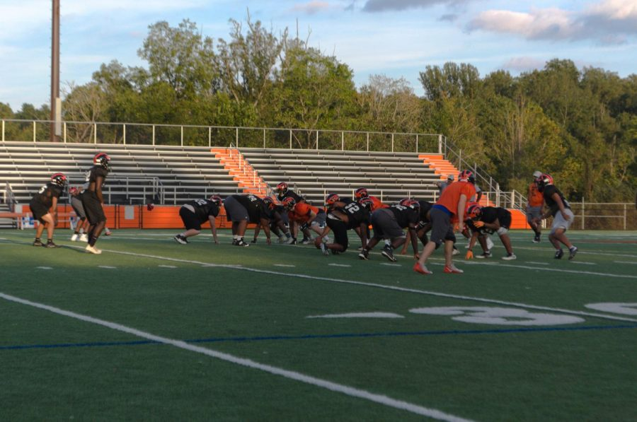 The CHS football team practices.