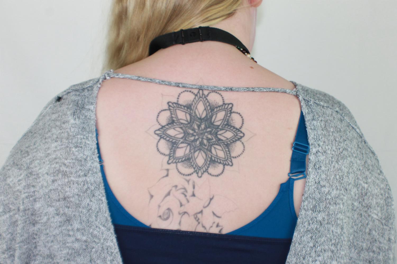 137eacad0 C.H.S. teacher Ms. Smith has a mandala tattoo between her shoulder blades.