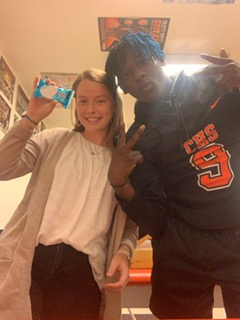Ashlyn and Tamarius flexing a Rice Krispie treat.