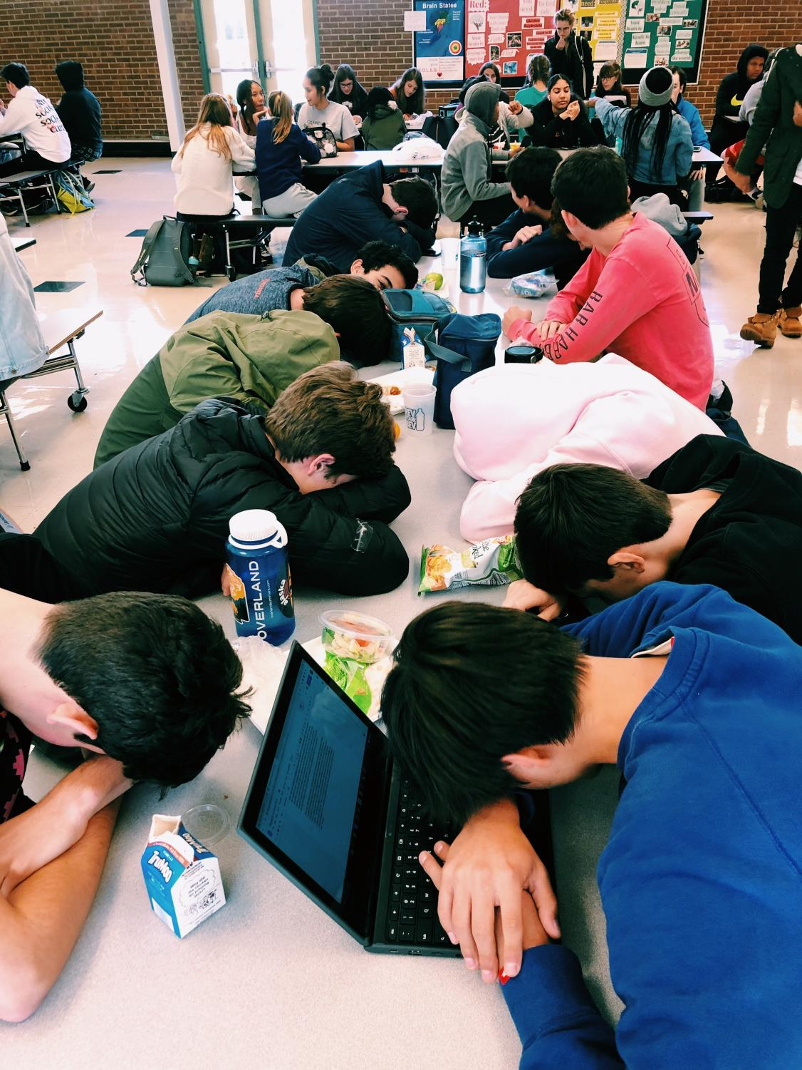Several sophomore student athletes experiencing exhaustion during their lunch period.