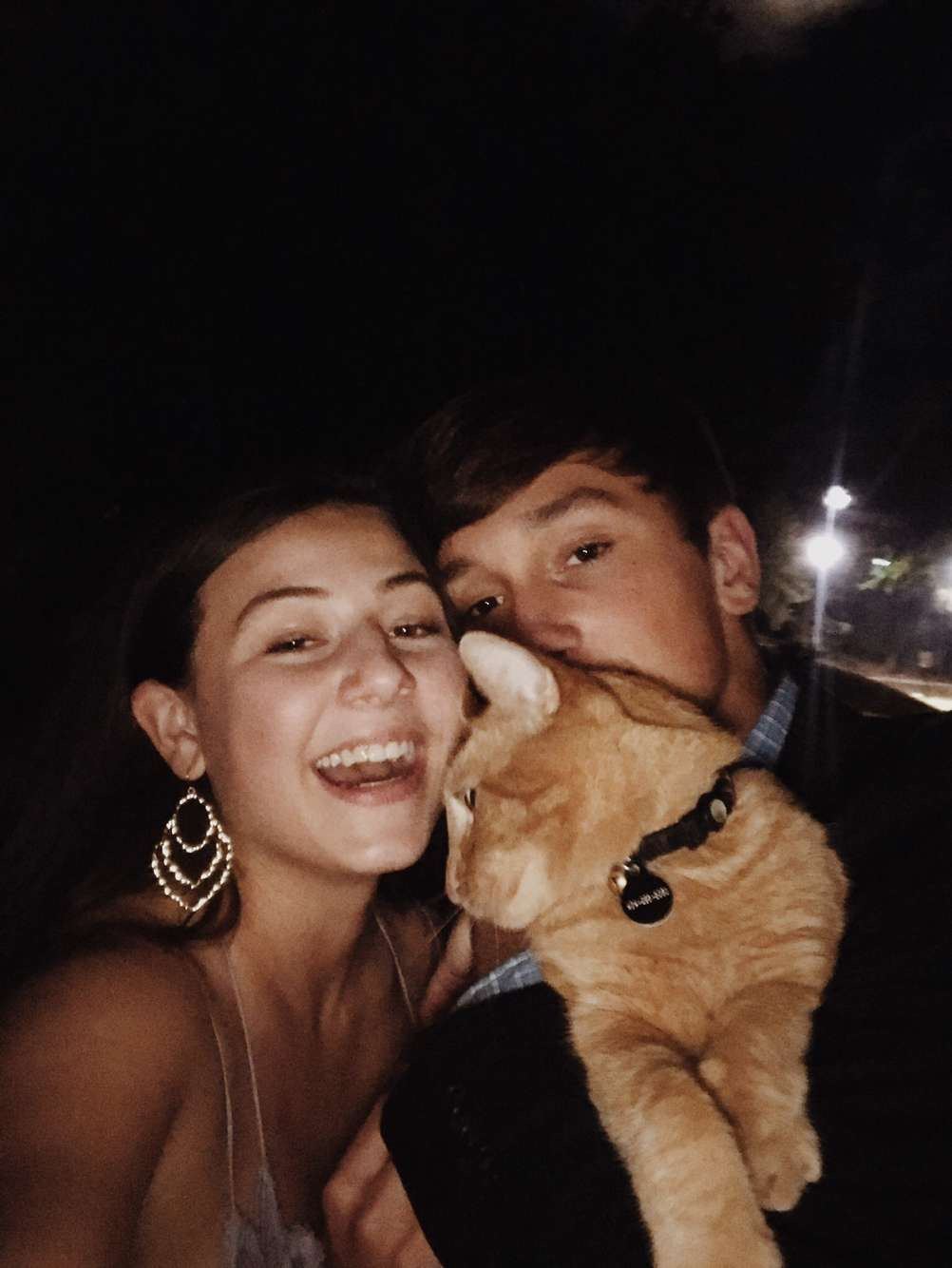 Chloe and Caden hold our local CHS cat and snap a picture on Homecoming night.