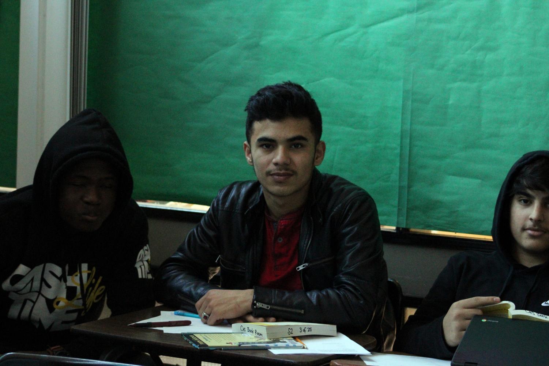 Students in E.S.L. classroom ( Tariq Mukhlis, Peniel Mutombo, Jalil Akbari)