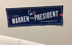 A campaign poster for Democratic candidate Elizabeth Warren, who has struggled in recent primary contests.