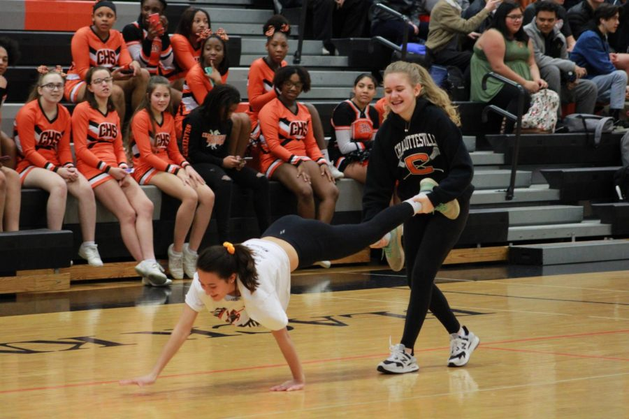 Isabelle+Buckner+and+Imogen+Armstrong+compete+in+one+of+the+annual+pep+rally+activities.+