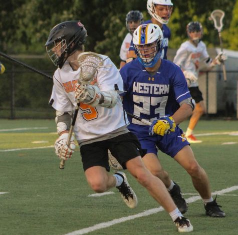 Senior Brendan Riley beats a Western defender during the 2019 lacrosse season.