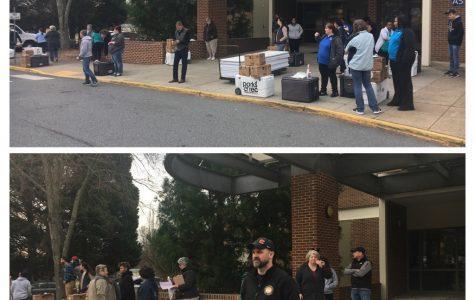 School officials prepare to distribute meals.