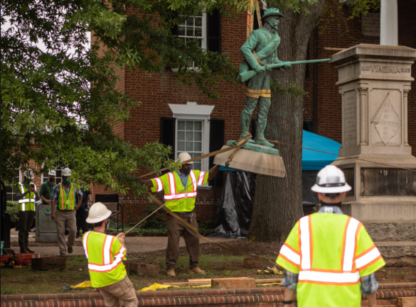 City workers removing the 100-year-old statue.