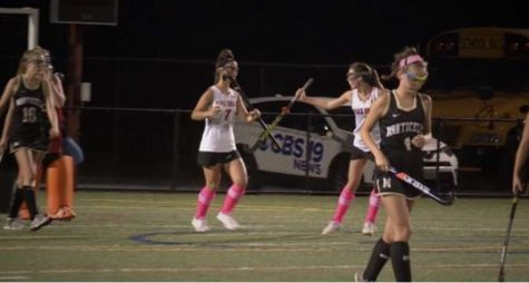 Field hockey players, Lucia Hoskins and Emmelia Kromkowski, celebrate after scoring a goal last season against Monticello.